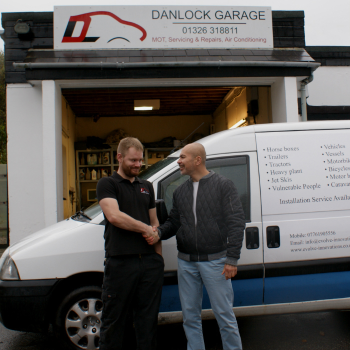 Two men shaking hands Evolve Innovations GPS Trackers with Danlock Garage
