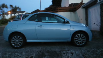 Side view of blue Nissan Micra Sport