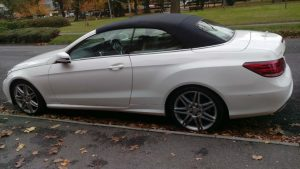 Side view of white Mercedes convertible